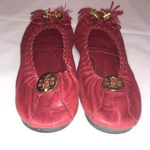 Tory Burch red tassel flats with gold hardware